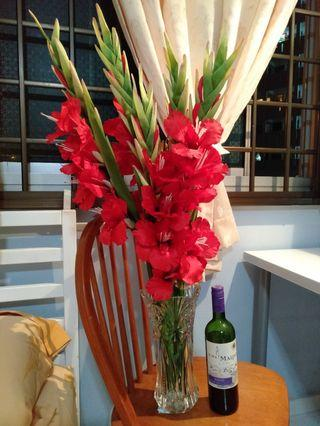 Gorgeous red lilies and glass vase