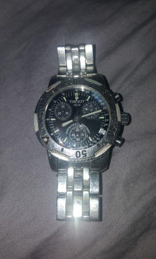 天梭石英腕錶。男女合用