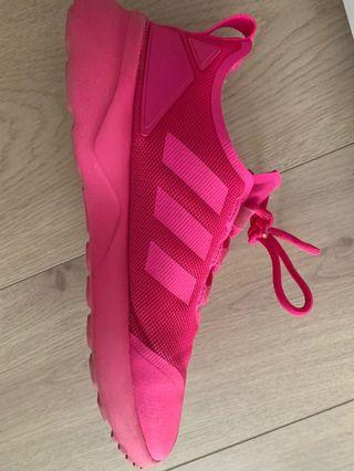 Bright pink sport shoes