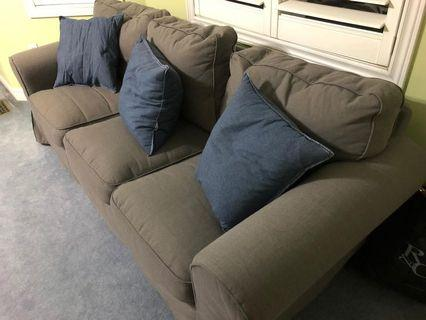 Grey IKEA couch with cushions