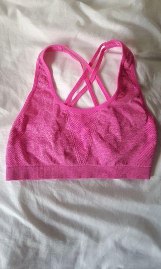 Pink strappy sports crop