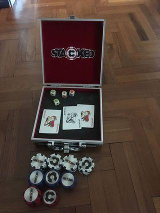 Stacked poker chips and case. No denominations.