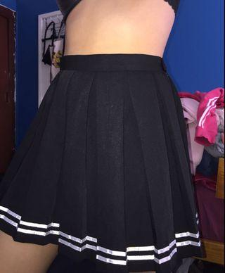 black pleated skirt with white stripes