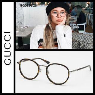 Gucci round metal frame glasses GG0393OK