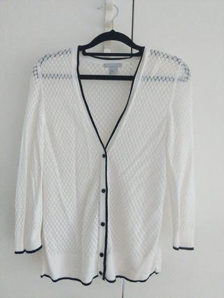 White cardigan with blue outline