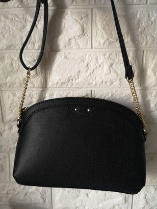 Dome-shaped crossbody bag