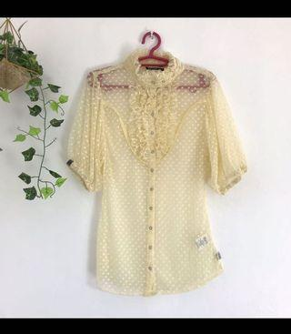 Yellow puff sleeved sheer top