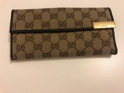 Gucci monogram leather wallet