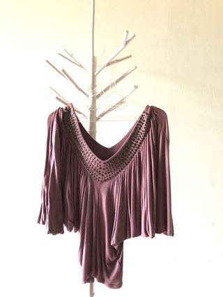 Nude with studed top