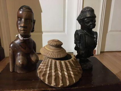 African stone pot and wooden figures