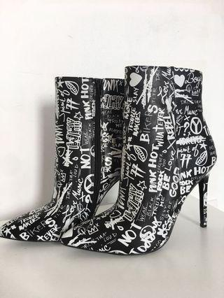 ALDO black and white booties