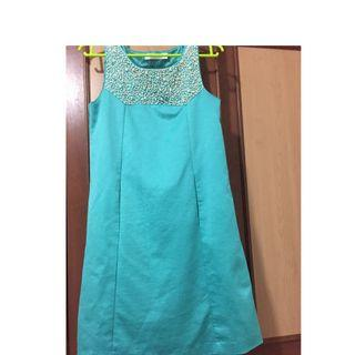 Turquoise knee-length dress with sequins