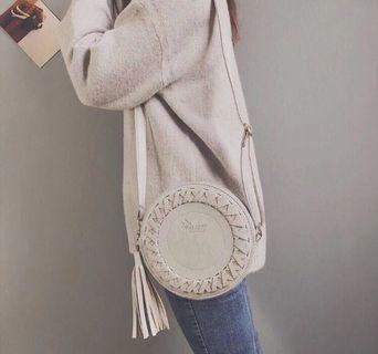 Circle tassle sling bag