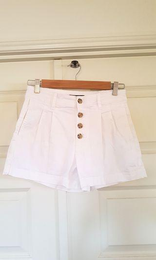 White shorts with buttons