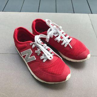 New Balance 574 red sneakers
