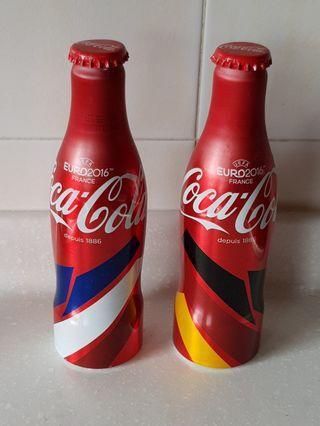 Metal Coca Cola bottles