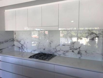 Glass kitchen Backsplash with marbled designs