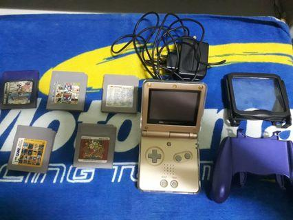 Nintendo Gameboy Advance SP AGS-001 with 100 games.