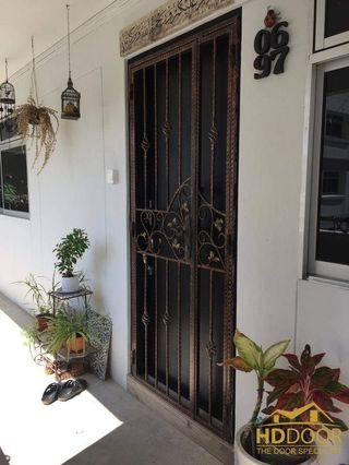 Wrought iron gate with laminated door