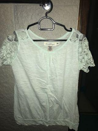 Light blue Tshirt with patterned sleeves.