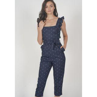 Klytie Frilled Jumpsuit in Navy Polka Dots