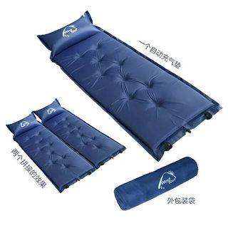 Foldable sleeping bag with inflatable pillow