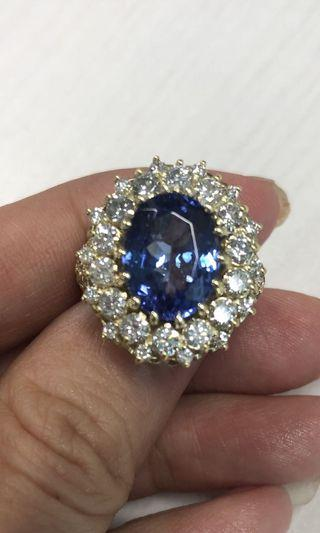 7.77 carat total weight tanzanite and diamond ring in solid 18k gold!