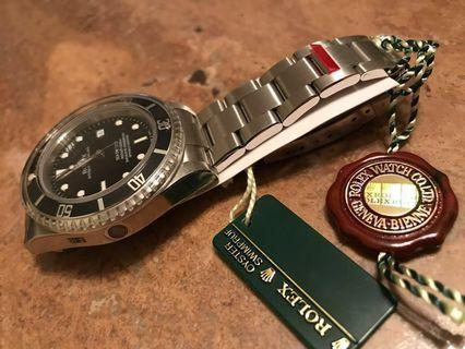 NOS M series 16600 Rolex Seadweller - complete with all stickers