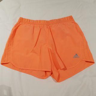 Nike neon coral running shorts