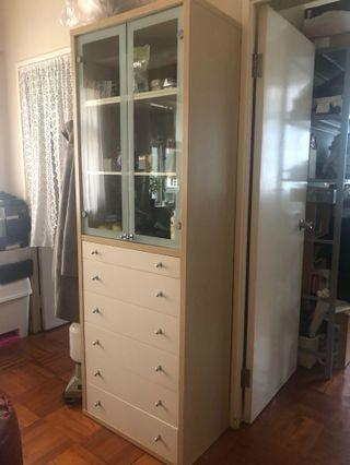Tall drawers with glass doors on top