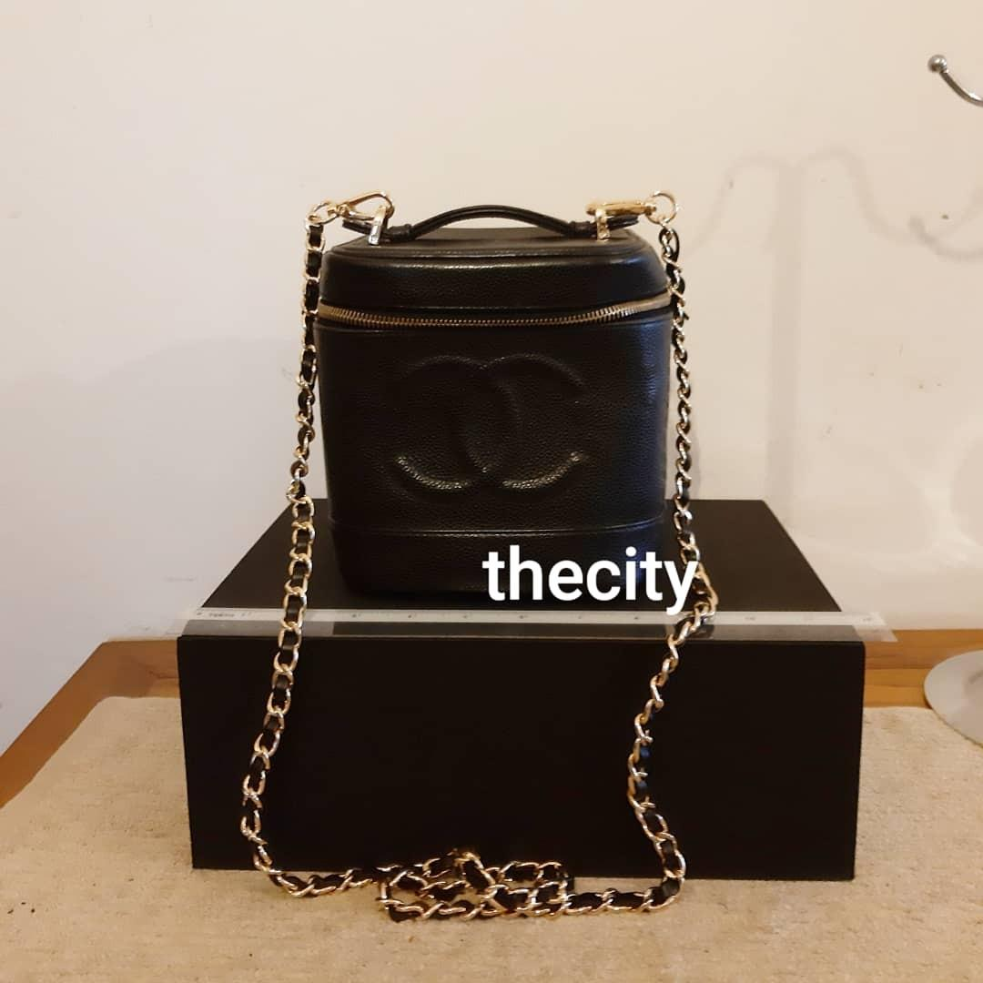 AUTHENTIC CHANEL VANITY BAG- BLACK CAVIAR LEATHER - CLEAN INTERIOR - SOLID SHAPE STRUCTURE - NEW ZIP PULL- DATE OF PURCHASE STICKER INTACT