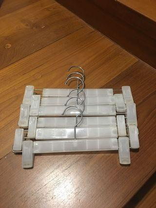 Clothes hangers with pegs