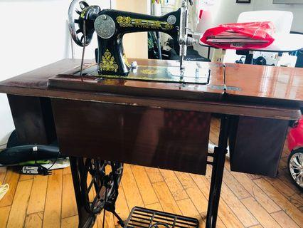 🚚 Antique sewing machine flying man