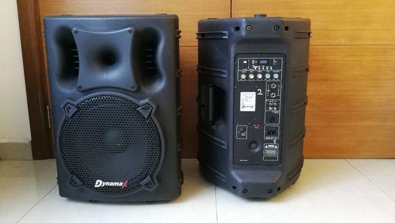 "One pair of Dynamax 15"" active portable speakers"
