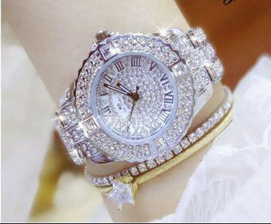 🚚 Stylish silver and gold watches for ladies.