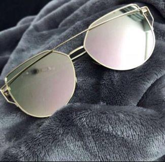 Rose gold and gold sunglasses