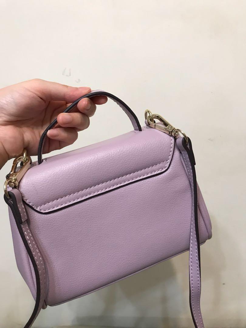 真皮 粉紫色袋 100%new