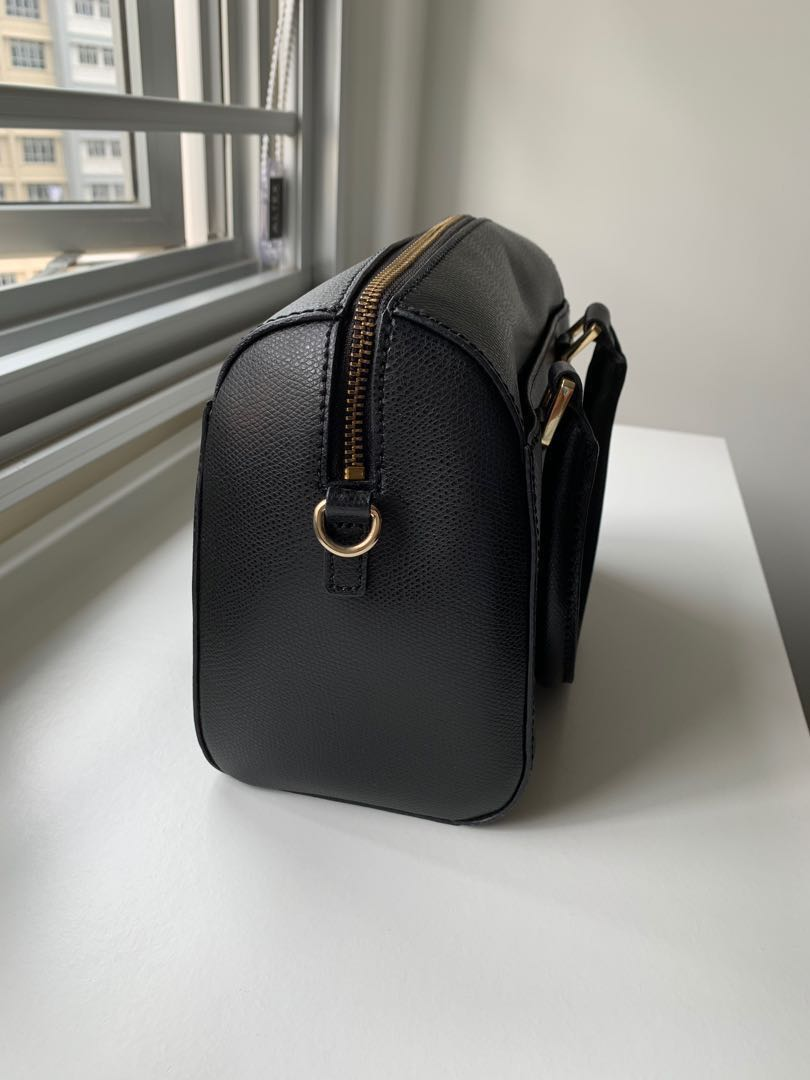 71d213fd10e Calvin Klein mini duffle bag in black, Women's Fashion, Bags ...