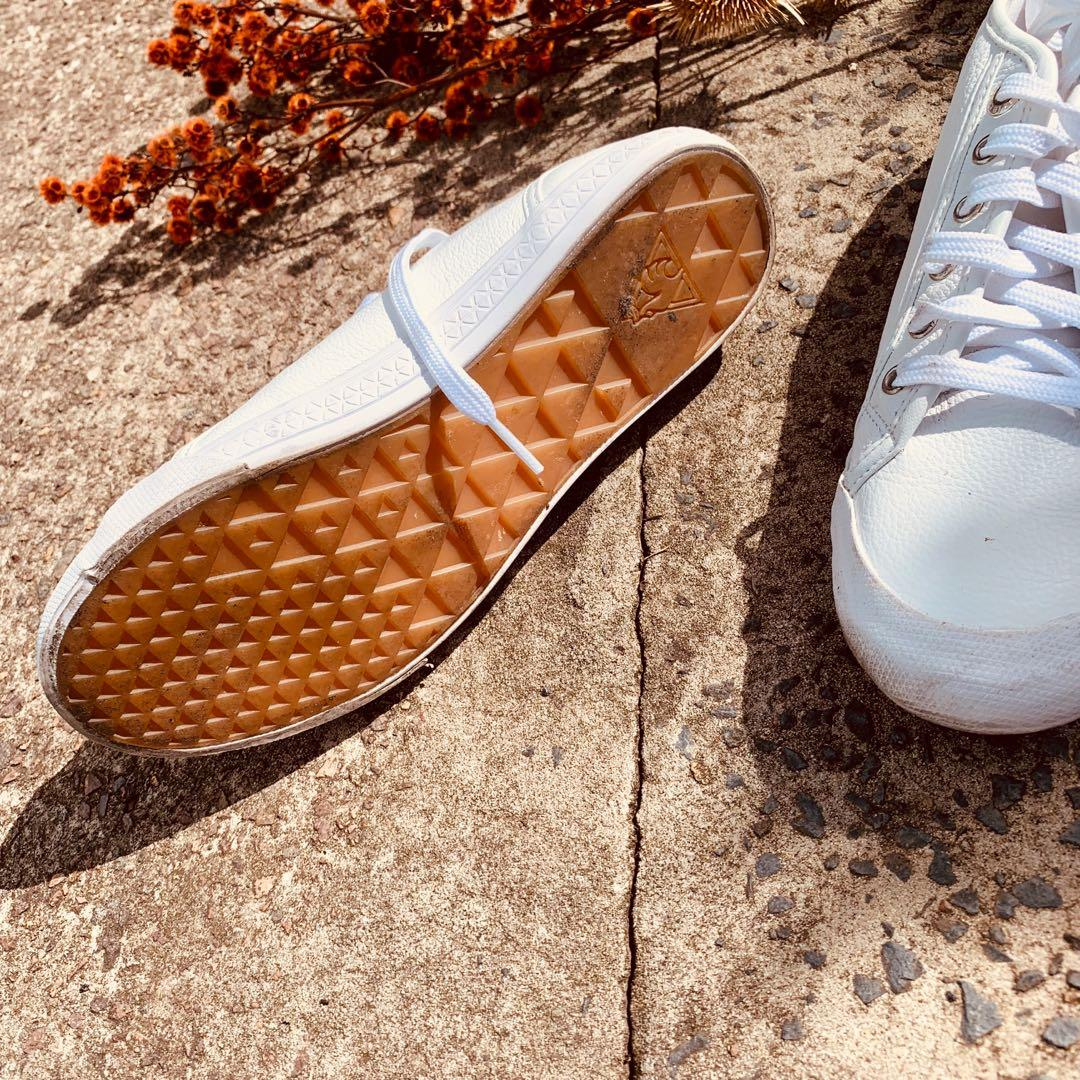 Le Coq Sportif white leather sneakers tagged a women's size 6, more of a true 7