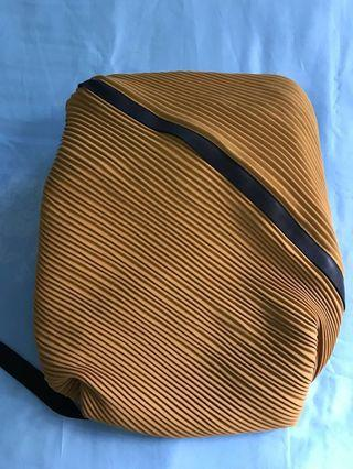 Pleats Please backpack by Issey Miyake