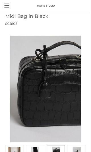 Faux croc leather sling bag from Matte studio