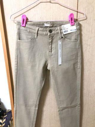 全新 uniqlo 米色 特級彈性牛仔褲 25腰(63.5公分)