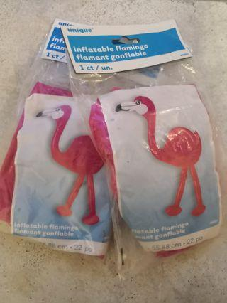 2 inflatable flamingoes