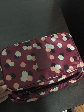 🚚 Traveling bra bag in maroon floral print
