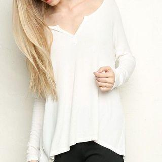 white long-sleeved brandy top