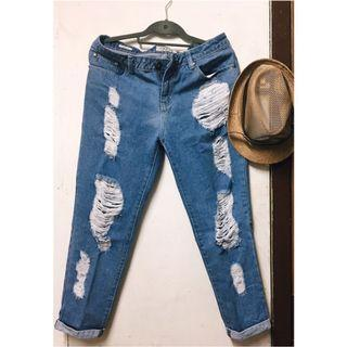 Folded and Hung Ripped Jeans