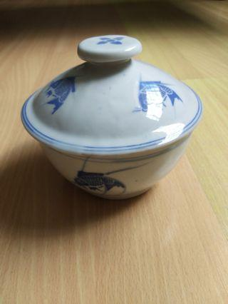 Vintage porcelain Bowl with cover unused and kept for at least 20 years