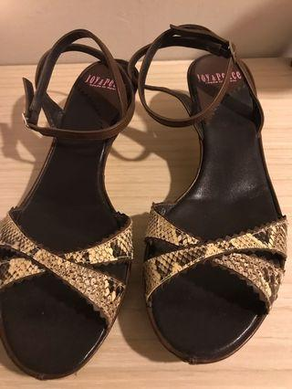 A Pair Of Snake Skin Sandals