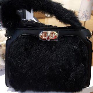 Furry elegant handbag