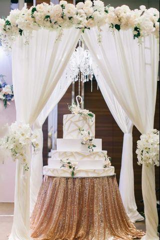 Customised wedding floral gazebo with fabrics sash